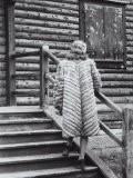 Model Posing on the Steps of a Mountain Chalet Wearing a Light Colored Fur with Dark Stripes - A. Villani