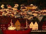 Fishing Vessel Moored in Front of Wooden Buildings on the Bryggen Waterfront, Bergen, Norway - Anders Blomqvist