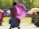 Brightly Colored Umbrellas are Twirled at a Festival in Thimphu