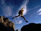 Hiker Jumping Between Rocks in the Wasatch Mountains, Wasatch-Cache National Forest, Utah, USA - Cheyenne Rouse