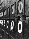 Boy Running Scoreboard at Griffith Stadium During the Baseball Game - Hank Walker