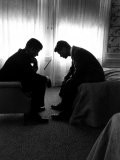 Jack Kennedy Conferring with His Brother and Campaign Organizer Bobby Kennedy in Hotel Suite - Hank Walker