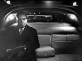 VP Richard Nixon Sitting Solemnly in Back Seat of Dimly Lit Limousine - Hank Walker