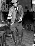 Man Playing Quoits, Like Horse Shoes, in an English Pub - Hans Wild