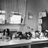 The Dionne Quintuplets Writing on Pieces of Paper During a Class at School - Hansel Mieth
