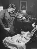 Violinist Yehudi Menuhin, Playing the Violin for His New Baby Daughter in Hotel Room - Hansel Mieth
