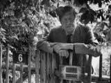 Poet, Wystan H. Auden, Standing Outside Gate of His Home - Harry Redl