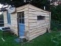 cabane en palette et bardage bois