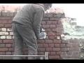 Décaper un mur en brique peint