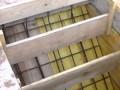 Mise en place des coffrages pour la réalisation d'un escalier béton