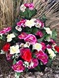 Composition de fleurs artificielles lesté totalement ciment pour une très bonne tenue à l' extérieur vu son poids. Réalisé par ...