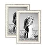 Ensemble de 2 cadres photo en bois massif blanc, style campagne et nature, dimensions: 20x30 cm. Accessoires et verres inclus.