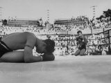 Buddhist Prayers at Beginning of the Prefight Ceremony of Muay Thai Boxing - Jack Birns