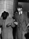 Former US State Department Official Alger Hiss Handcuffed to a Thief Being Led Away from Courthouse - Jack Birns