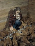 Girl Pets Chickens She Has Come to Feed in a Hen House - Jack Fletcher