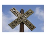 Railroad Crossing Sign with Mold and Bullet holes against Blue Sky - James Davidson