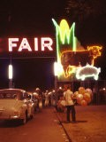 Man Selling Balloons at Entrance of Iowa State Fair - John Dominis