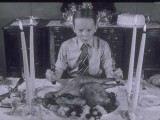 Boy Sits Dow to Thanksgiving Dinner - Lambert