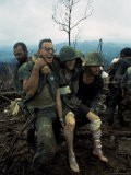 American Marines Aid a Wounded Comrade During Intense Battle for Hill 484 - Larry Burrows