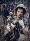 Dirty, Exhausted Looking US Marine on Patrol with His Squad Near the DMZ During the Vietnam War - Larry Burrows
