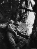 Helicopter Chief James C. Farley Working Jammed Machine as Pilot Lt. James Magel Dying Beside Him - Larry Burrows