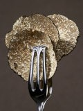 Truffle Slices in Tongs - Marc O. Finley
