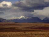 Scenic View of Snow-Capped Mountains, Clouds, and Grasslands - Marcia Kebbon