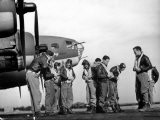 B-17 Flying Fortress Crew of 8th Bomber Command Donning Their Flying Gear Upon Arrival by Jeep - Margaret Bourke-White