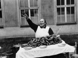 Vendor Trying to Sell Bundles of Sausage - Margaret Bourke-White