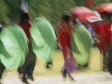 Brightly Colored Umbrellas are Twirled at a Festival in Thimphu - Michael Melford