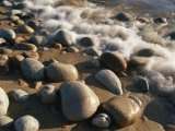 Water Washes up on Smooth Stones Lining a Beach - Michael S. Lewis