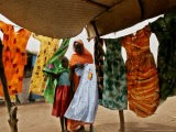 A Sudanese Woman Buys a Dress for Her Daughter at the Zamzam Refugee Camp - Nasser Nasser
