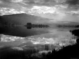 Atmospheric Landscape with Clouds and Hills Reflected in Water - Nat Farbman