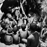 Chief Acts Out a Story to Bushman Children, Southern Kalahari Desert in Central Southern Africa - Nat Farbman