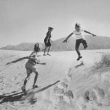 Children Playing in the Desert Sand - Nat Farbman