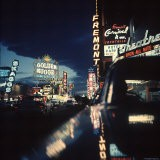 Fremont Street at Night Lit Up by Gambling Casino Neon Signs - Nat Farbman