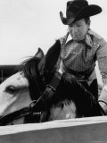 Rodeo Star Casey Tibbs Sitting in the Pen at a Rodeo Just Before His Horse Threw Him - Nat Farbman