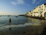 A Beach Goer Wades into the Calm Surf of Cadaques - Pablo Corral Vega