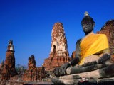 Buddha Statue in Yellow Silk with Ruins in Background - Paolo Cordelli