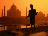 Silhouetted Fisherman by Yamuna River with Taj Mahal in Background - Paolo Cordelli