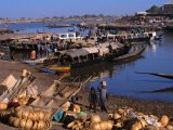 Fully Laden Pinasses Docked at the Jetty with More Cargo on the Shores of the Niger River, Mali - Patrick Syder