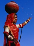 Performer Dancing with Water Pot at Holi Festivities, Jaipur, India - Paul Beinssen