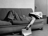 Writer Niven Busch Lying on Sofa with Newspaper over His Face as He Takes Nap from Screenwriting - Paul Dorsey