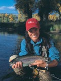 Woman Fly Fishing in Co, Holding Fish - Paul Gallaher