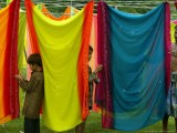 A Washerman with His Children Hang Clothes - Rajesh Kumar Singh