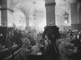 Interior of Munich Beer Hall, People Sitting at Long Tables, Toasting - Ralph Crane