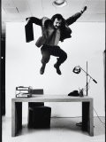 Architect and Designer Frank Gehry Jumping on a Desk in His Line of Cardboard Furniture - Ralph Morse