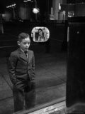 Boy Watching TV on Store Window Set, Glass Reflects the Image Off TV Screen - Ralph Morse