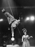 Circus Performer Balancer Unus Standing on His Index Finger on Globe Feet in Air Back of Head - Ralph Morse