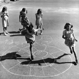 Girls Playing Hopscotch in the Street - Ralph Morse